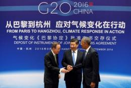 Chinese President Xi Jinping (C), UN Secretary General Ban Ki-moon and U.S. President Barack Obama (R) shake hands during a joint ratification of the Paris climate change agreement ceremony ahead of the G20 Summit at the West Lake State Guest House in Hangzhou, China, September 3, 2016. REUTERS/How Hwee Young/Pool